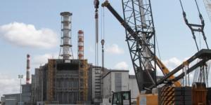 ITAR-TASS: KIEV REGION, UKRAINE. APRIL 26, 2012. A new safe confinement under construction around the 4th Reactor at Chernobyl Nuclear Plant. (Photo ITAR-TASS / Maria Frolova)  Óêðàèíà. Êèåâñêàÿ îáëàñòü. 26 àïðåëÿ. Ñòðîèòåëüñòâî çàùèòíîãî ñîîðóæåíèÿ (áåçîïàñíîãî êîíôàéíìåíòà) íàä 4-ì áëîêîì ×åðíîáûëüñêîé ÀÝÑ. Ôîòî ÈÒÀÐ-ÒÀÑÑ/ Ìàðèÿ Ôðîëîâà