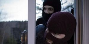 Two burglars entering home